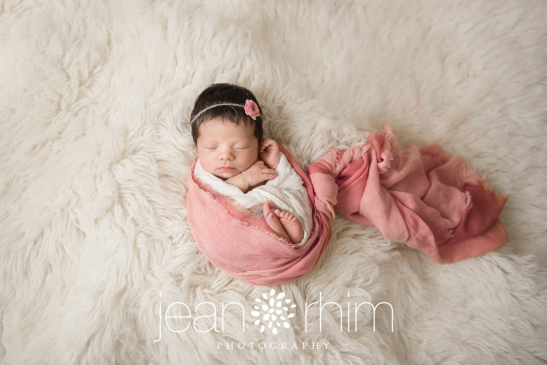 Emma was the picture of sweet serenity during her session her peaceful expressions and the way she naturally touched her hands to her face were so lovely